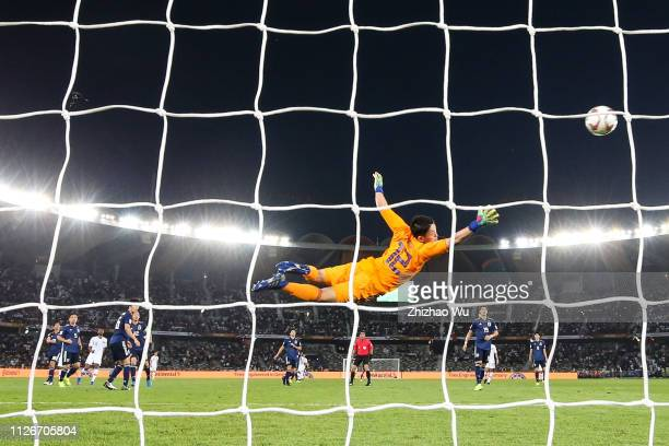 Abdel Aziz Hatim of Qatar scoring the second goal against Gonda Shuichi of Japan as he flies to save the during the AFC Asian Cup final match between...
