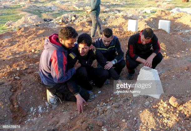 Abdel Hameed Alyousef mourns over his wife and twin babies killed in the chemical attack by Assad Regime at their cemetery in Idlib Syria on April 6...