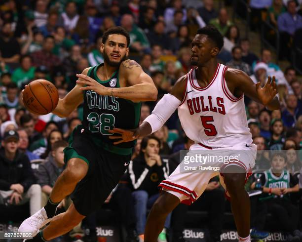 Abdel Nader of the Boston Celtics drives on Bobby Portis of the Chicago Bulls during the second half of the game at TD Garden on December 23 2017 in...