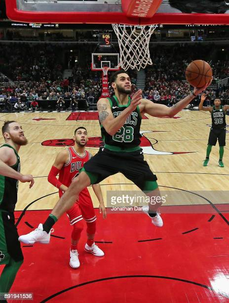 Abdel Nader of the Boston Celtics drives past Denzel Valentine of the Chicago Bulls at the United Center on December 11 2017 in Chicago Illinois NOTE...