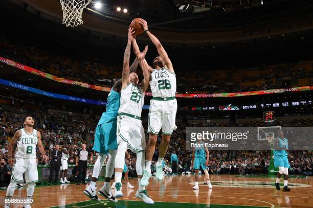 Abdel Nader of the Boston Celtics grabs the rebound against the Charlotte Hornets during a preseason game on October 2 2017 at the TD Garden in...