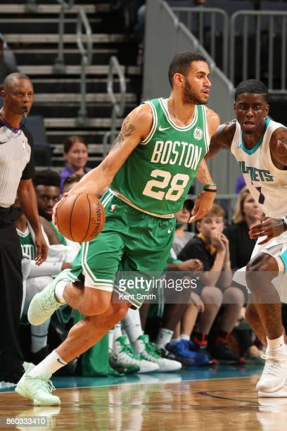 Abdel Nader of the Boston Celtics handles the ball against the Charlotte Hornets on October 11 2017 at Spectrum Center in Charlotte North Carolina...