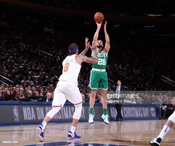 Abdel Nader of the Boston Celtics shoots the ball against the New York Knicks on December 21 2017 at Madison Square Garden in New York City New York...