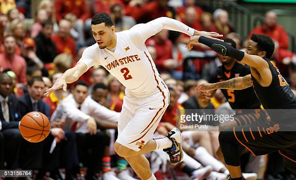 Abdel Nader of the Iowa State Cyclones battles for the ball with Jeff Newberry of the Oklahoma State Cowboys in the first half of play at Hilton...