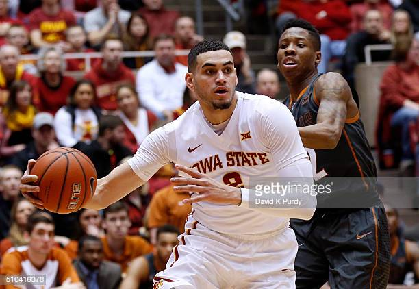 Abdel Nader of the Iowa State Cyclones drives the ball as Kerwin Roach Jr #12 of the Texas Longhorns puts pressure on in the first half of play at...