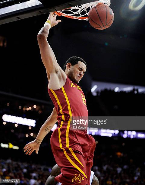 Abdel Nader of the Iowa State Cyclones dunks against the Kansas Jayhawks in the first half during the championship game of the Big 12 Basketball...