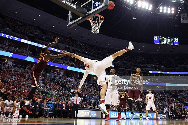 Abdel Nader of the Iowa State Cyclones is foulded by A.J. English of the Iona Gaels during the first round of the 2016 NCAA Men's Basketball...