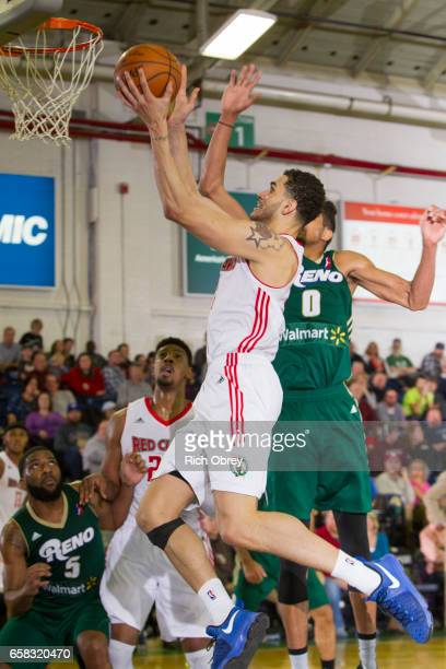 Abdel Nader of the Maine Red Claws shoots around Will Davis II of the Reno Bighorns on Sunday March 26 2017 at the Portland Expo in Portland Maine...