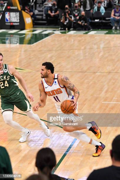 Abdel Nader of the Phoenix Suns handles the ball against the Milwaukee Bucks during Game Three of the 2021 NBA Finals on July 11, 2021 at Fiserv...