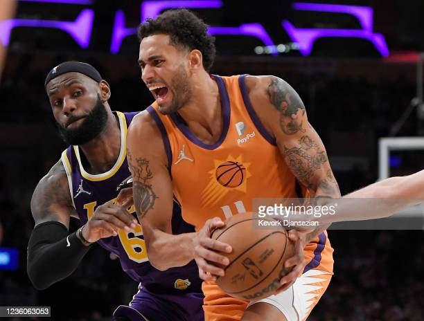 Abdel Nader of the Phoenix Suns has the ball knock out by Austin Reaves of the Los Angeles Lakers with LeBron James defending during the second half...