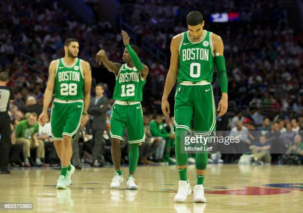 Abdel Nader Terry Rozier and Jayson Tatum of the Boston Celtics play against the Philadelphia 76ers at the Wells Fargo Center on October 20 2017 in...