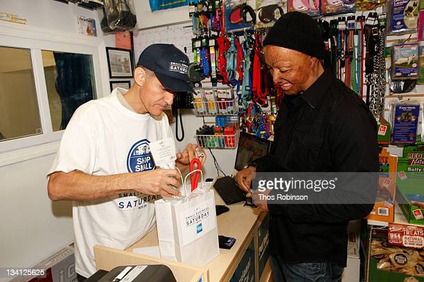 Abdel Rios owner of Skillman Pets and actor JR Martinez at Skillman Pets shops locally for Small Business Saturday founded by American Express on...