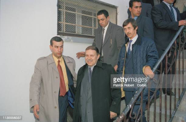 Abdelaziz Bouteflika and his brother Saïd behind him on the right during a campaign meeting in the town of Anaba Algeria