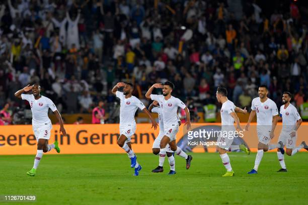 Abdelaziz Hatim of Qatar celebrates scoring his side's second goal with his team mates during the AFC Asian Cup final match between Japan and Qatar...