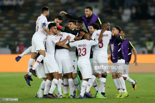 Abdelaziz Hatim of Qatar celebrates with teammates after scoring his team's second goal during the AFC Asian Cup final match between Japan and Qatar...