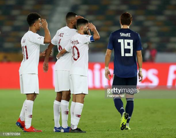 Abdelaziz Hatim of Qatar celebrates with teammates Hasan Al Haydos and Akram Hassan Afif after scoring his team's second goal during the AFC Asian...