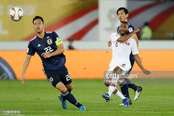 Abdelaziz Hatim of Qatar scores his team's second goal past Maya Yoshida of Japan during the AFC Asian Cup final match between Japan and Qatar at...