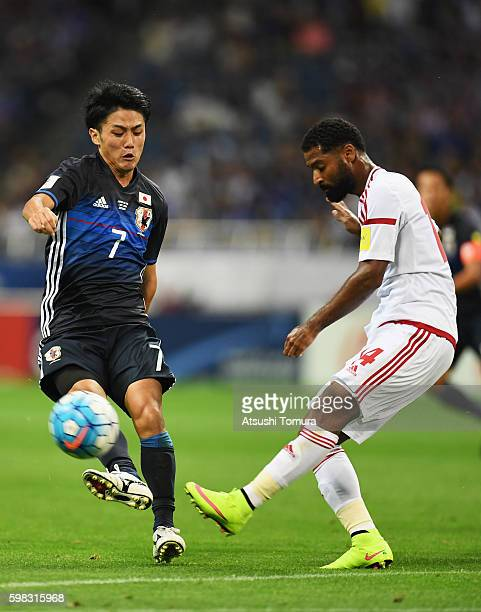 Abdelaziz Sanqour of the United Arab Emirates and Ryota Ohshima of Japan compete for the ball during the 2018 FIFA World Cup Qualifier Final Round...
