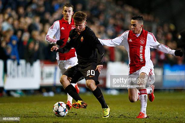 Abdelhak Nouri of Ajax battles for the ball with Christian D'Urso of Roma during the UEFA Youth League Round of 16 match between Ajax Amsterdam and...