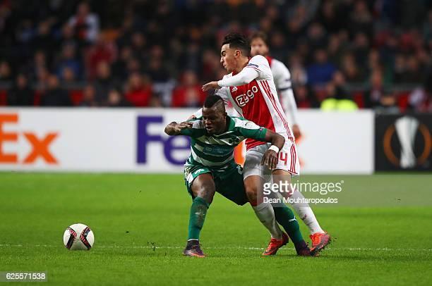 Abdelhak Nouri of Ajax battles with Wakaso Mubarak of Panathinaikos during the UEFA Europa League Group G match between AFC Ajax and Panathinaikos FC...