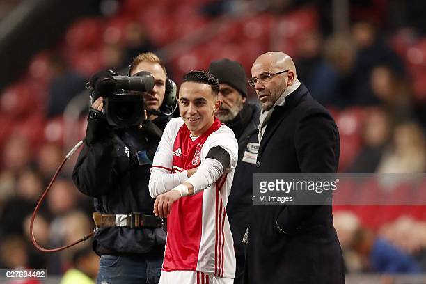 Abdelhak Nouri of Ajax coach Peter Bosz of Ajaxduring the Dutch Eredivisie match between Ajax Amsterdam and FC Groningen at the Amsterdam Arena on...