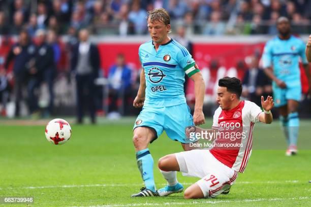Abdelhak Nouri of Ajax tackles Dirk Kuyt of Feyenoord Rotterdam during the Dutch Eredivisie match between Ajax Amsterdam and Feyenoord at Amsterdam...