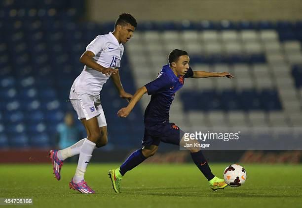 Abdelhak Nouri of Netherlands U18 controls the ball from Dominic Solanke of England U18 during the U18 International Friendly match between England...