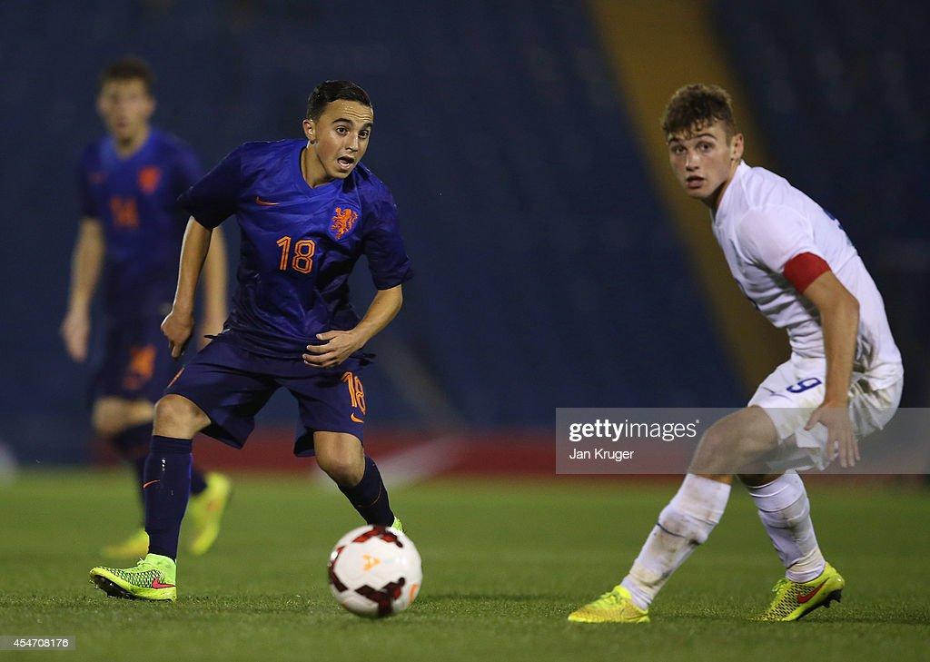 Abdelhak Nouri of Netherlands U18 controls the ball from Ryan Ledson of England U18 during the U18 International Friendly match between England U18 and Netherlands U18 at JD Stadium on September 5, 2014 in Bury, England.