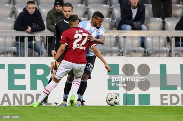 Abdelhamid Sabiri of 1 FC Nuernberg and Amilton of TSV 1860 Muenchen battle for the ball during the Second Bundesliga match between TSV 1860 Muenchen...