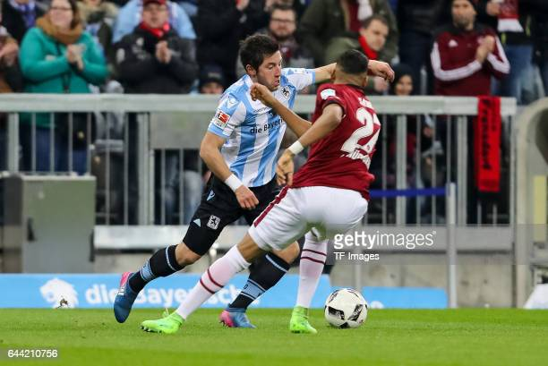 Abdelhamid Sabiri of 1 FC Nuernberg and Maximilian Wittek of TSV 1860 Muenchen battle for the ball during the Second Bundesliga match between TSV...