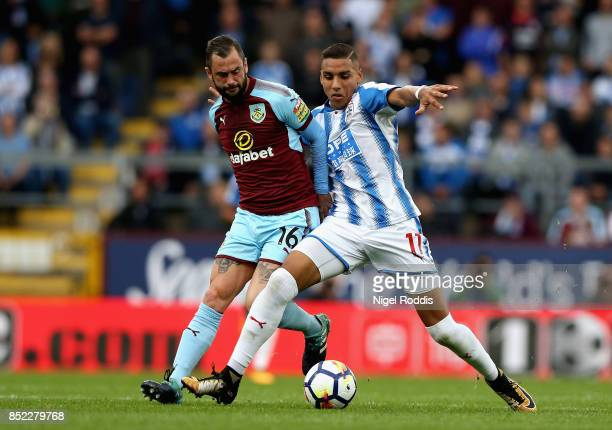 Abdelhamid Sabiri of Huddersfield Town and Steven Defour of Burnley compete for the ball during the Premier League match between Burnley and...