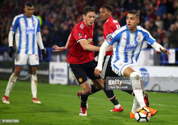 Abdelhamid Sabiri of Huddersfield Town is challenged by Nemanja Matic of Manchester United during the The Emirates FA Cup Fifth Round between...