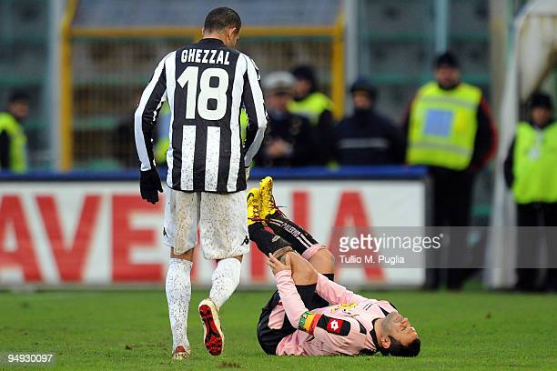 Abdelkader Ghezzal walks over to Palermo teammate Fabrizio Miccoli as he lies injured on the ground during the Serie A match between US Citta di...