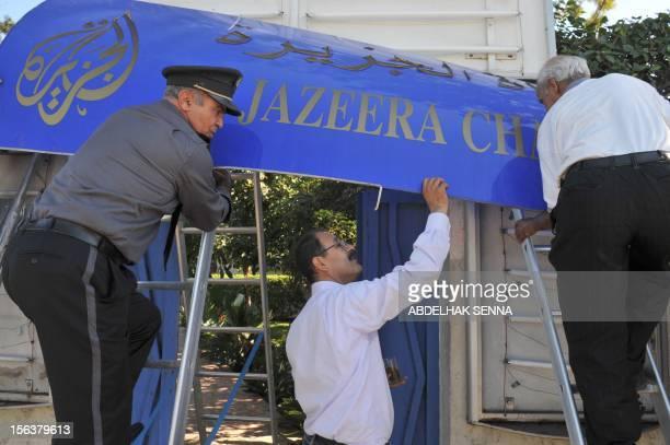 Abdelkader Kharroubi Rabat bureau chief of the panArab television network AlJazeera watches the dismantling of the TV station's sign on November 4...