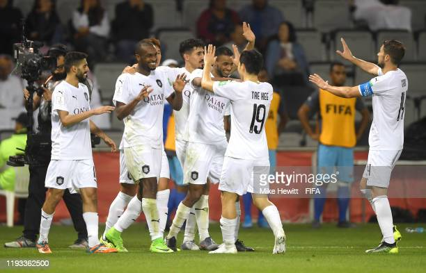 Abdelkarim Hassan of AlSadd Sports Club celebrates with teammates after scoring his team's second goal during the FIFA Club World Cup Qatar 2019...