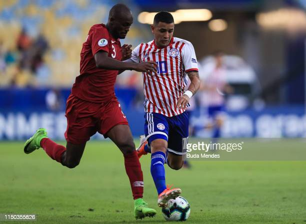 Abdelkarim Hassan of Qatar and Derlis González of Paraguay compete for the ball during the Copa America Brazil 2019 group B match between Paraguay...