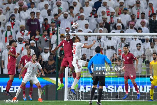 Abdelkarim Hassan of Qatar and Ismail Ahmed Mohamed of the UAE jumps for a header during the AFC Asian Cup semi final match between Qatar and United...