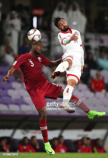 Abdelkarim Hassan of Qatar competes with Abdullah Otayf of Lebanon during the AFC Asian Cup Group E match between Qatar and Lebanon at Hazza Bin...