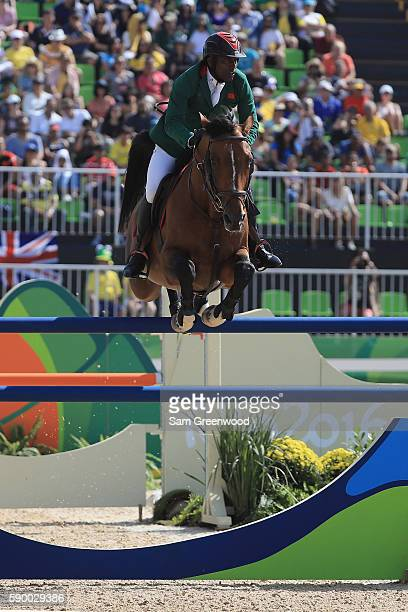 Abdelkebir Ouaddar of Morocco rides Quickly De Kreisker during the Individual Jumping on Day 11 of the Rio 2016 Olympic Games at the Olympic...