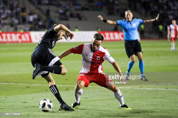 Abdellah Zoubir of Qarabag is tackled by Joel Cooper of Linfield during the UEFA Europa League Play-Off: Second Leg between Qarabag and Linfield at...