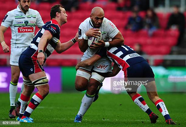 Abdellatif Boutaty of Pau is tackled by Jack Wallace of Bristol Rugby during the European Rugby Challenge Cup match between Bristol Rugby and Pau at...