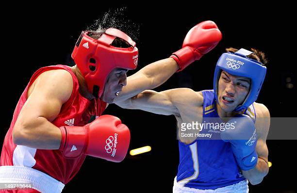 Abdelmalek Rahou of Algeria in action with Ryota Murata of Japan during the Men's Middle Boxing on Day 6 of the London 2012 Olympic Games at ExCeL on...