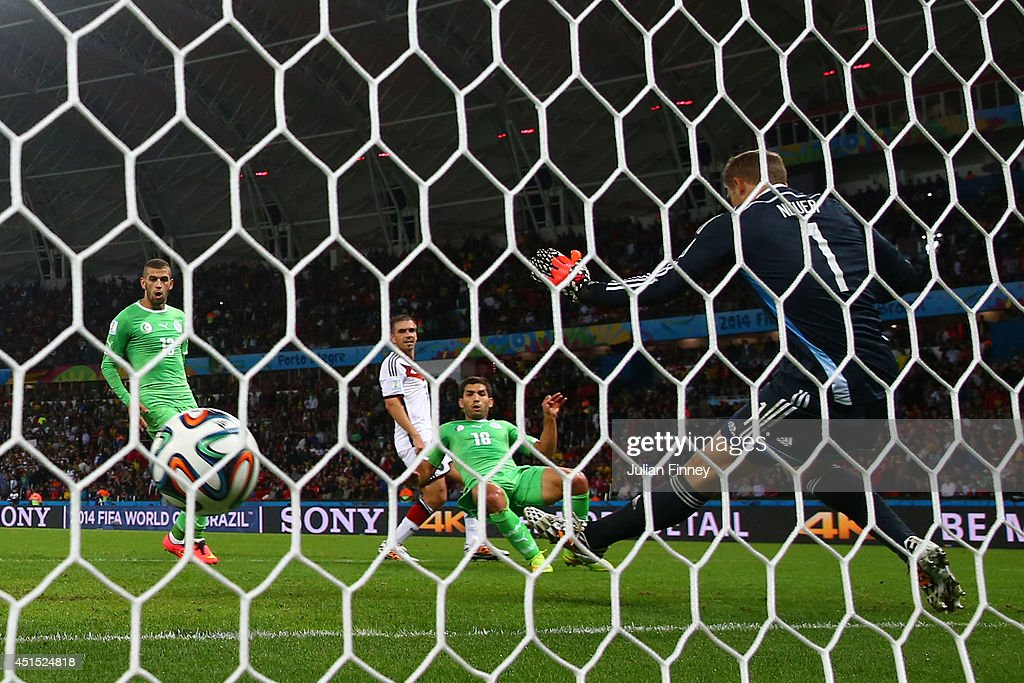 Abdelmoumene Djabou of Algeria scores his team's first goal past Manuel Neuer of Germany in extra time during the 2014 FIFA World Cup Brazil Round of 16 match between Germany and Algeria at Estadio Beira-Rio on June 30, 2014 in Porto Alegre, Brazil.