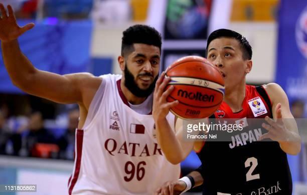 Abdelrahman Yehia Abdelhaleem of Qatar defends against Yuki Togashi of Japan during the FIBA World Cup Asian Qualifier match between Qatar and Japan...