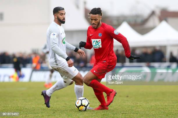 Abdelwahed Benmebarek of Houilles and Julio Donisa of Concarneau during the french National Cup match between Houilles and Concarneau on January 6...