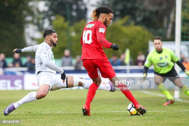 Abdelwahed Eenmebarek of Houilles and Julio Donisa of Concarneau during the french National Cup match between Houilles and Concarneau on January 6...