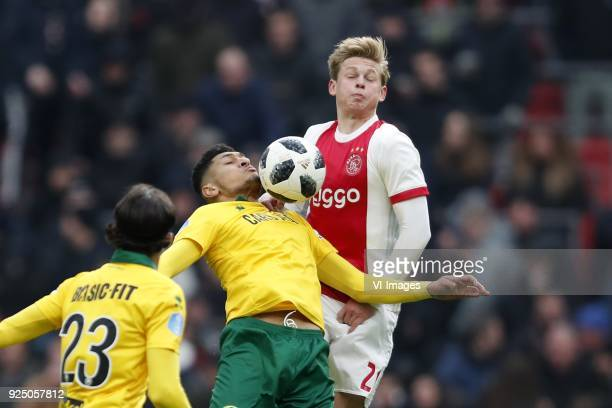 Abdenasser El Khayati of ADO Den Haag Bjorn Johnsen of ADO Den Haag Frenkie de Jong of Ajax during the Dutch Eredivisie match between Ajax Amsterdam...