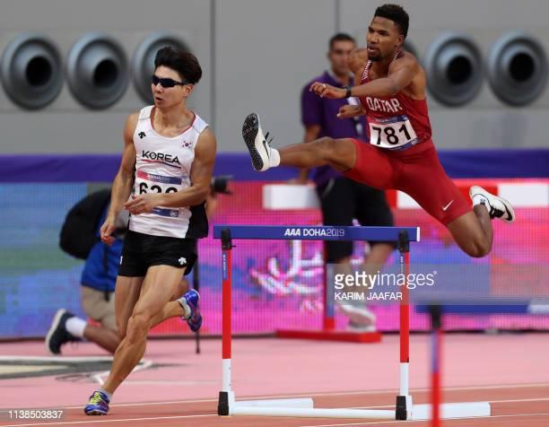 Abderrahman Samba of Qatar and Lim Chanho of South Korea compete in thew 400m men's hurdles during 23rd Asian Athletics Championships at Khalifa...