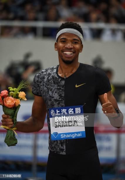 Abderrahman Samba of Qatar celebrates after winning the men's 400m hurdles athletics event during the IAAF Diamond League competition in Shanghai on...