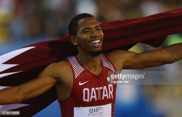 Abderrahman Samba of Qatar celebrates victory after the Men's 400 metre hurdles during the Doha IAAF Diamond League 2017 at the Qatar Sports Club on...
